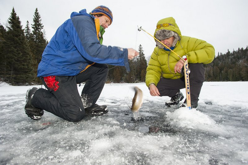 boys outdoors ice fishing stock photo